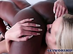 Ebony lesbian Anna Foxxx is licking pussy of naughty white babe in 69 style pose