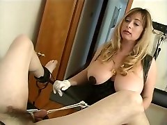Big tits mistress Cristian pulling on her slaves cock with a rope