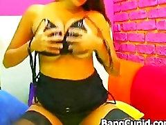 Big breasted beauty masturbating on webcam