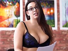 Chubby secretary in stockings and lingerie Sophie Parker is sitting on the office table