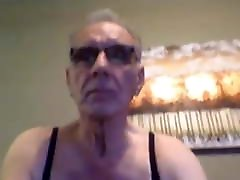 Mature grandpa in bra and nylons shows his thick cock
