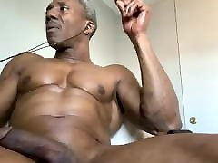 Muscled cumed on guy smoking while stroking