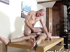 Twink sex Brit youngster Oli Jay is roped down to the table, his sleek