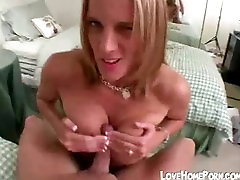 Big boobed chick gives handjob