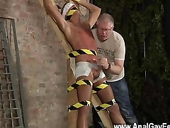 Hot twink scene Hes roped up to the cross in just his undergarments when