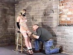 Mature blonde BBW slut entangled in fetish BDSM