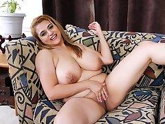 MILF Mia Jones strips and plays, big tits
