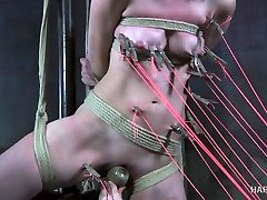 Angry wife punishes husbands bitch in the dark BDSM room