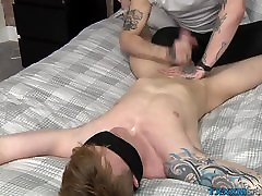 Twink bottom sub enjoys being tied up and cock teased in bed