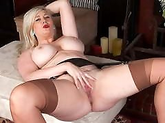 Buxom blonde secretary fingers hard in nylons and high heels