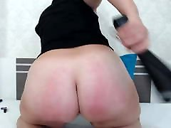 Bdsm mature punishes herself with a belt