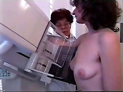 real mammography on small empty saggy tits
