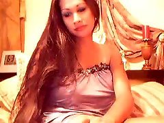 Slutty shemale stripping and stroking on cam.
