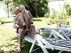 French busty MILF fucks him sweetly on the chair in her backyard