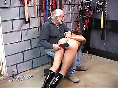 Slut is bent over and in pain with lashes on her ass from paddle