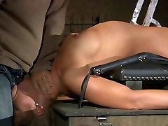 Busty slave tied by a pillar and bodily whipped