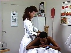 Doctor gets horny to suck big massive black cock on the bed