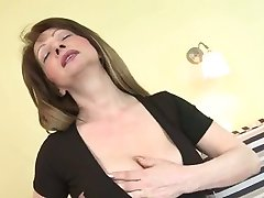 Busty mature fucks her holes to a wet orgasm