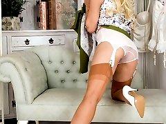 Exhibitionist Nina stripping down to her vintage bra, garter belt and sheer panties!