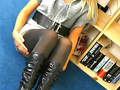 Beautiful blonde Lucy-Anne shows off her lovely legs in a thick grey minidress with dark...