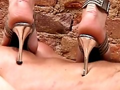 Helpless shaggy slave gets trampled by a leggy mistress wearing spike heels