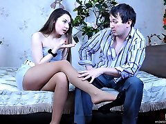 Dark-haired teaser dangles her shoe ready to get creamed feet after raw sex