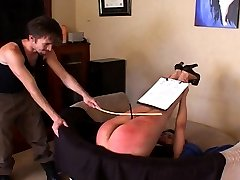 He brought the cane, which he uses on her ass, thighs, and the back of her legs. This real...