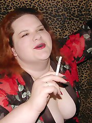 Hot busty BBW redhead smoking a cigarette