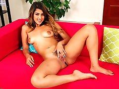Exotic babe Sophia Leone fingering trimmed pussy.