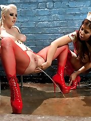 Cherry Torn and Mia Gold get down and dirty as they play with each others asses in tight fetish...