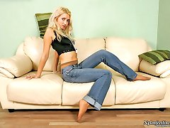 Blonde cutie in tan pantyhose and denim caressing her sexy feet with beads