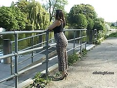 As she patiently waits by the waterside Lauryn taps her sexy thin heel repeatedly on the hard concrete, tap tap tap and the sound and the look of her shoe, lovingly styled to do things for you all over again