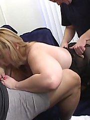 A wild blonde takes two cocks