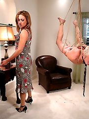 Gwen Diamond and Little Billy's first MIP pairing revealed such a hot chemistry that we had to have them back for PART TWO - in which Gwen has the bad boy doing chores while wearing her panties under his clothing.  To further remind him of his status in the household, she unleashes a very hard whipping on him, humiliates him verbally, suspends and beats him and eventually uses his pathetic cock for her own pleasure.  After she finally allows the panty boy to come inside her pussy, she squats on his face and squeezes the sticky goo out all over his mouth and face, laughing at him all the time.