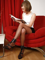 Naughty babe bares her tits while posing in her tan slight sheen pantyhose