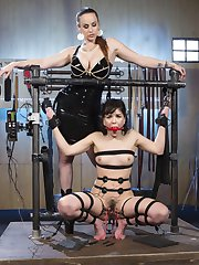 Scared Electroslut Juliette March is bound, gagged, electrified, and at the mercy of the gorgeous Bella Rossi. Juliette submits to a thorough flogging while her abs are shocked with e-stim pads and her pussy is held open by electrified close-pins. Next Juliette's ass is plugged with an electric anal plug and she has tons of orgasms while getting fucked by a large dick-on-a-stick. After Juliette pleases her Mistress with pussy licking, Juliette is rewarded with lots of orgasms during an intense anal fucking with a metal electrified dildo.