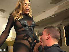 Yasmin Lee 2 weeks in a row! Need I say more? Yasmin slays in this Bionic Woman parody, tossing Alexander around and shoving her huge hard cock deep down his throat and fucking him like only Yasmin Lee can! He also gets to suck on her beautiful feet and blow his load all over her toes. This makes Yasmin so hot she blows one of the most epic loads from her beautiful cock we've ever seen! Not to be missed!