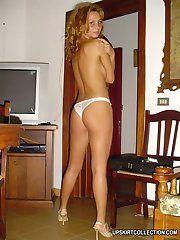 Bare titted girl poses in white panties against the wall