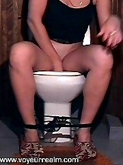 Spy on pissing babe with hidden toilet cam