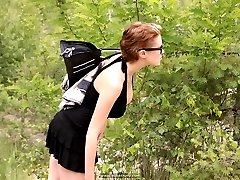 Cute girl with glasses tanning in nature