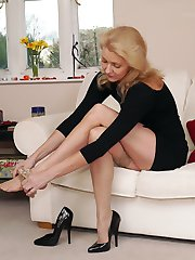 Blonde Milf Magdalena shows off her long legs in a pair of silky nylon stockings and tall black stiletto heels