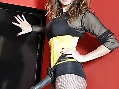 Femdom Belt Cock Jane plays with her fat strapon trunk dressed in fishnets, boots and yellow corset