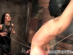 Mistress Sandra Romain taunts Lefty while he suffers in painful predicament with his hard cock tied to a wall and a hook up his ass pulling in the opposite direction.When the pain becomes too much, he is bent over and fucked up the ass to strip his manhood, and finally his cock is used and drained for Mistress' pleasure.