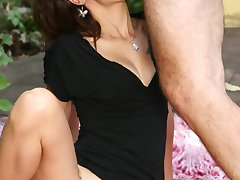 Slutty hirsute lady Leslie gives a blowjob and fucks a dick with her wet hairy pussy in the outdoors