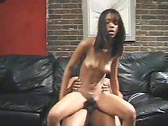 Slim ebony babe pumping bushy twat on top of meaty dick