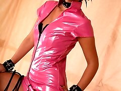 Kinky slut wears pink latex