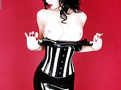 stacked vamp in corset and tight rubber dress
