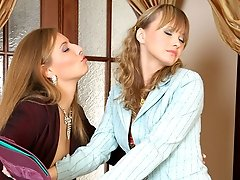 Lusty business-lady wetting a girl�s pussy and shoving her strap-on into it