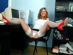 Secretary in white stockings spreading her legs