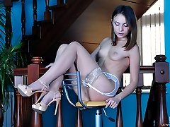 Naughty show-off in a yellow gown and sheer nylons makes use of a glass toy